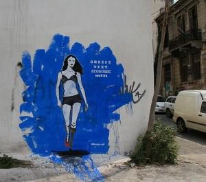 """""""Das nächste ökonomische Super-Modell"""" (mit Holzbein) - Graffiti in Athen"""
