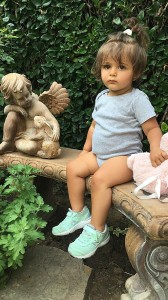 Toddler_sitting_on_a_bench